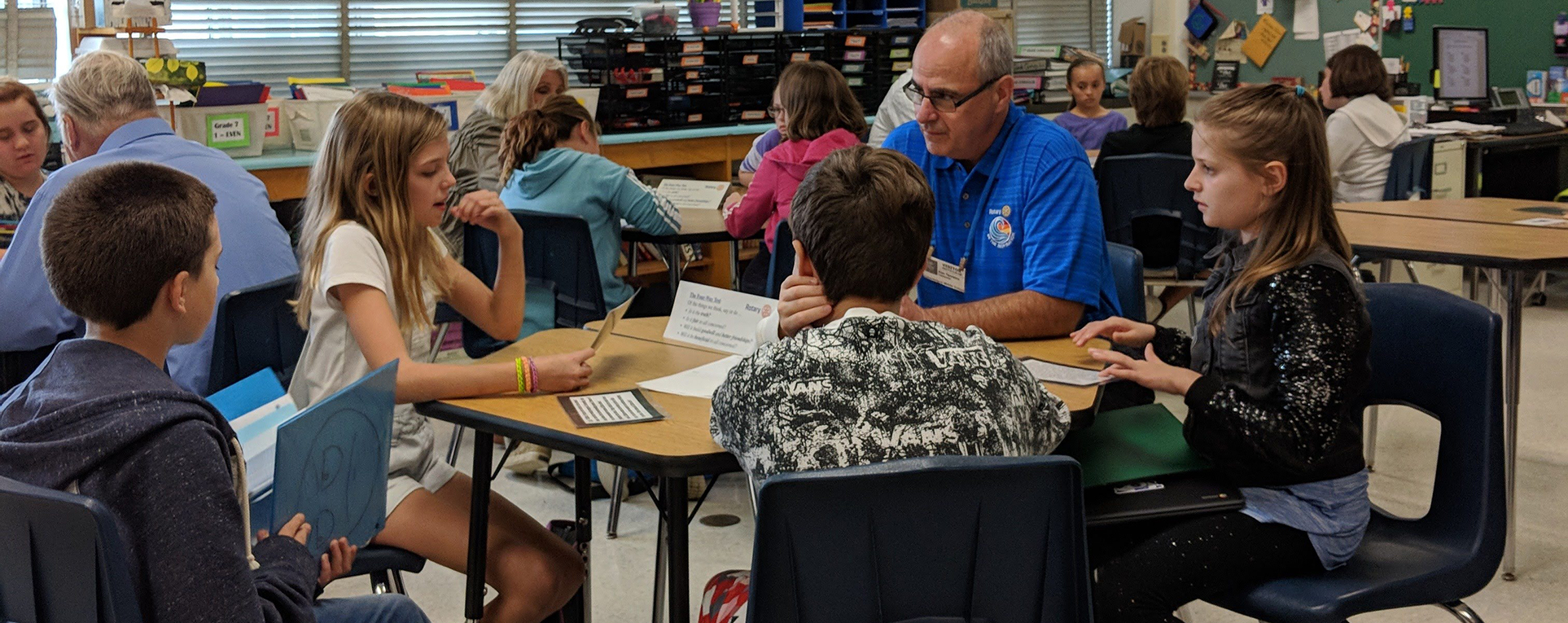 Students talk to adult about Rotary