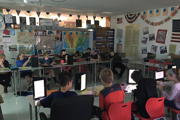 ms students with their chromebooks in class