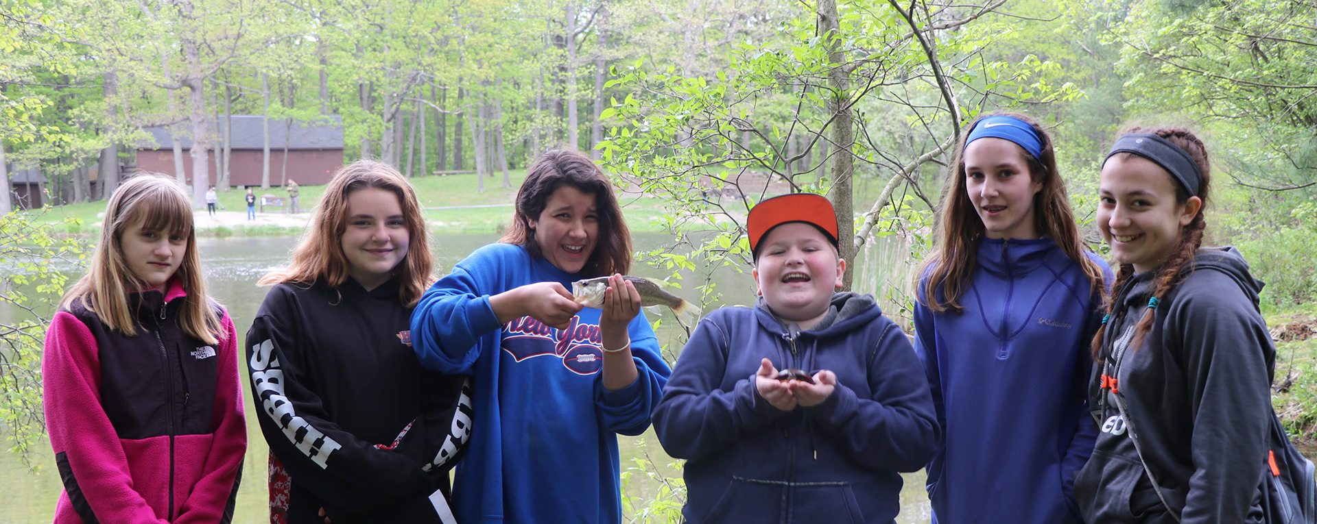 6th grade students at camp bristol hills.  girl and boy holding frog and turtle